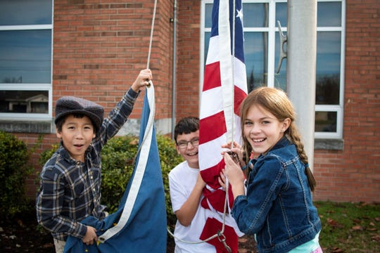 Tristen Stennett, Nathin Plummer and Cierra Mobley are 4th graders at Poston Road Elementary School in Martinsville, IN. They are tasked with putting up and taking down the U.S. flag each day. Not pictured is classmate LiliAnna Spilker, who kept running off during the photo session.