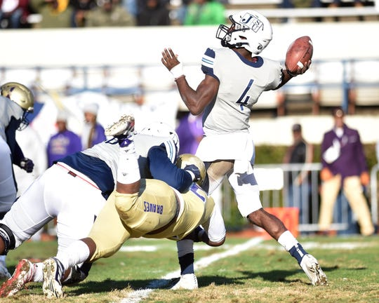 Jackson State QB Jalon Jones (4) is hit while he throws during a game in Jackson on Saturday, Nov. 23, 2019, at Mississippi Veterans Memorial Stadium. Alcorn beat JSU 41-6.