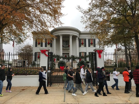 A group protesting mass incarceration in Mississippi marched around the governor's mansion in downtown Jackson on Saturday, Nov. 23, 2019.