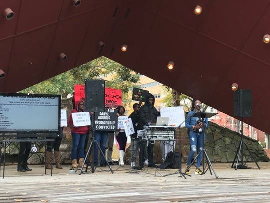 Attendees of a rally against mass incarceration in Mississippi hold signs calling for justice on Saturday, Nov. 23, 2019.