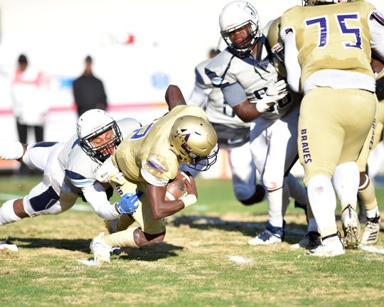 Alcorn State University QB Felix Harper (2) is tackled by Jackson State University defense during a game in Jackson against JSU on Saturday, Nov. 23, 2019 at Mississippi Veterans Memorial Stadium. Alcorn beat JSU 41-6.
