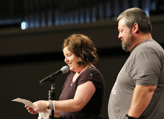 """Lori Smith reads a statement of thanks to the crowd that was at West Jackson Baptist Church in June for """"A Night of Glory for Lori,"""" which was a benefit concert for her soon after she received a cancer diagnosis."""