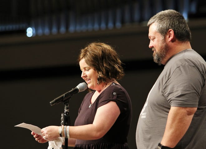 "Lori Smith reads a statement of thanks to the crowd that was at West Jackson Baptist Church in June for ""A Night of Glory for Lori,"" which was a benefit concert for her soon after she received a cancer diagnosis."