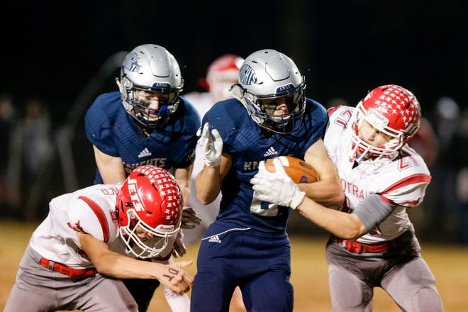 Central Catholic's Ty Buche (2) is stopped by Adams Central's Alex Currie (21) and Adams Central's Dallas Schwaller (9) during the first quarter of the IHSAA class A semi-state football game, Friday, Nov. 22, 2019 in Lafayette. Central Catholic won, 24-14.
