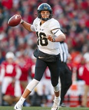 Nov 23, 2019; Madison, WI, USA; Purdue Boilermakers quarterback Aidan O'Connell (16) throws a pass during the first quarter against the Wisconsin Badgers at Camp Randall Stadium. Mandatory Credit: Jeff Hanisch-USA TODAY Sports