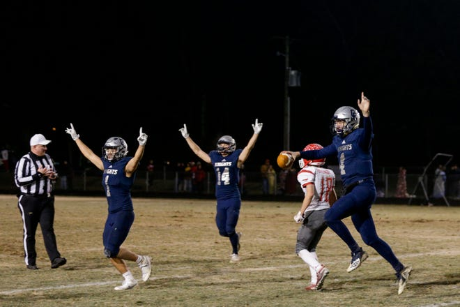 Central Catholic celebrates a 24-14 win over Adams Central to win the Class A Semi-State game, Friday, Nov. 22, 2019 in Lafayette.