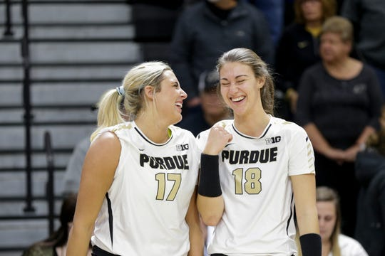 Purdue middle blocker Blake Mohler (17) and Purdue middle blocker Jael Johnson (18) share a moment before the first set of a NCAA women's volleyball game, Saturday, Nov. 23, 2019 at Holloway Gymnasium in West Lafayette.