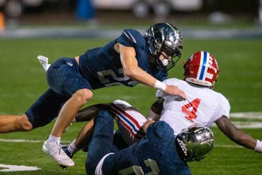 St. Thomas More's defense takes down the runner during the play as the St. Thomas More Cougars take on the Evangel Christian Academy Eagles on Friday, Nov. 22, 2019.