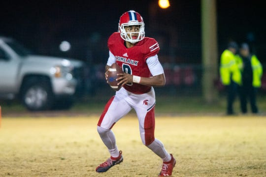 Comeaux High's quarterback Tre Harris looks for an open receiver during the play as the Comeaux High Spartans take on the Haughton High Buccaneers on Friday, Nov. 22, 2019.