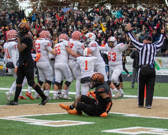 Brighton celebrates its game-winning touchdown with 50.1 seconds left in a 22-19 victory over Belleville in a state Division 1 football semifinal at Howell on Saturday, Nov. 23, 2019.