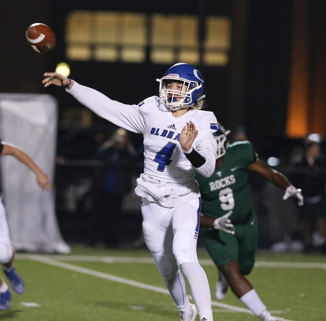 Oldham County QB Sam Young (4) passes against Trinity during their game at Trinity High School in Louisville, Ky. on Nov. 22, 2019.