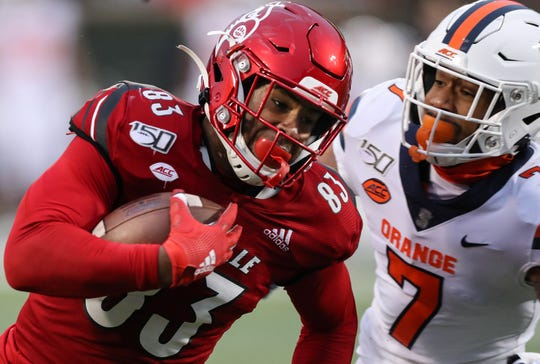 Louisville's Marshon Ford runs for a touchdown after the catch against Syracuse's Andre Cisco on Nov. 23, 2019