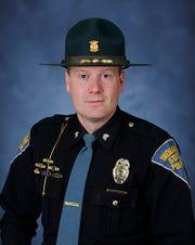 Indiana State Police Sgt. Stephen Wheeles helped save Megan Fleetwood from her patrially submerged car Friday, Nov. 22, on State Road 11 near Seymour in Jackson County, Indiana.
