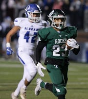 Trinity's Armon Tucker (23) beat an Oldham County defender to score a touchdown during their game at Trinity High School in Louisville, Ky. on Nov. 22, 2019.