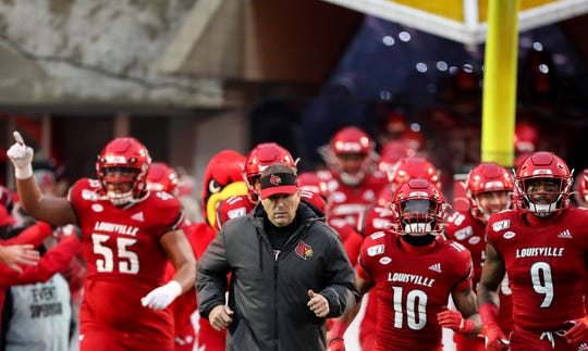 Louisville's Scott Satterfield leads his team on to the field before the game against Syracuse on Nov. 23, 2019