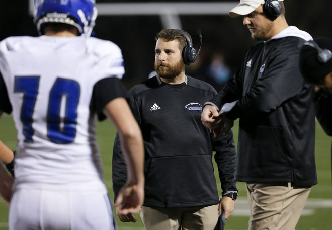 Oldham County head coach Michael Fox watched action against Trinity during their game at Trinity High School in Louisville, Ky. on Nov. 22, 2019.