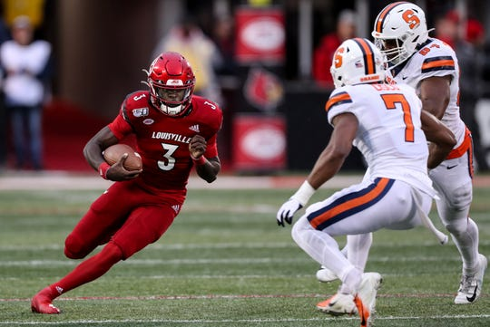 Louisville's Micale Cunningham tucks and runs against Syracuse on Nov. 23, 2019