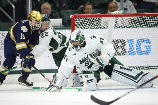 Michigan State goaltender John Lethemon freezes the puck against No. 3 Notre Dame  on Friday, November 22 at Munn Ice Arena. The Spartans and Irish tied 1-1