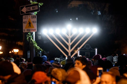 A large menorah is on display next to the official state tree during the Silver Bells in the City holiday event on Friday, Nov. 22, 2019, in downtown Lansing.