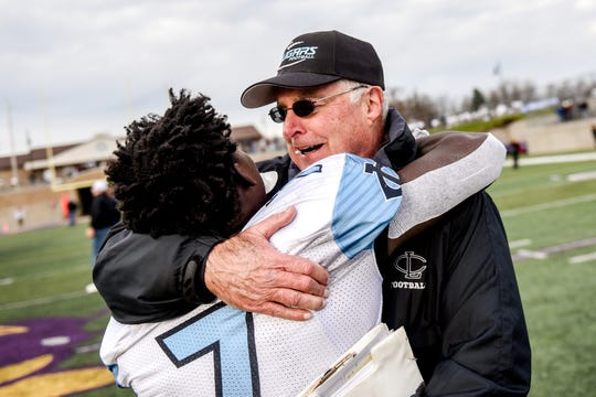 Lansing Catholic head coach Jim Ahern, right, hugs Mitch Raphael after beating Kingsley 28-14 on Saturday, Nov. 23, 2019, at Greenville High School. The victory was Ahern's 300th win.