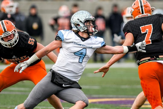 Lansing Catholic's Sam Edwards, left, pressures Kingsley quarterback Tyler Inthisone during the fourth quarter on Saturday, Nov. 23, 2019, at Greenville High School. Despite some other appealing opportunities, Edwards will continue his football career at Michigan State as a preferred walk-on.