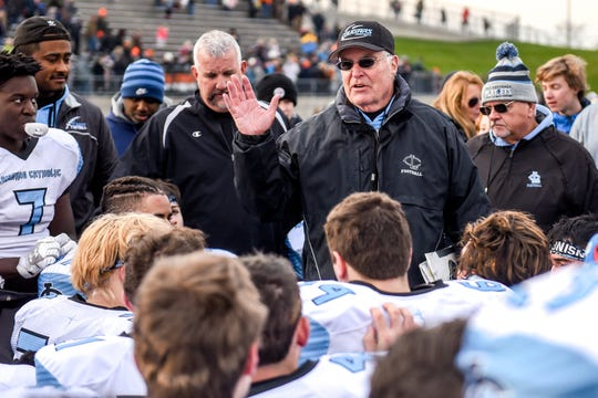 Lansing Catholic head coach Jim Ahern talks to the team after beating Kingsley 28-14 on Saturday, Nov. 23, 2019, at Greenville High School. The victory was Ahern's 300th win.