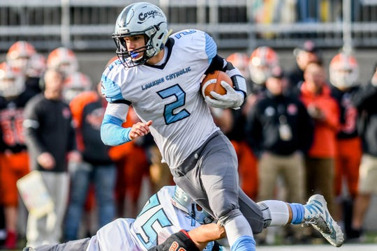 Lansing Catholic's Zach Gillespie runs for a gain during the fourth quarter on Saturday, Nov. 23, 2019, at Greenville High School.