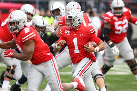 Ohio State quarterback Justin Fields was a true dual threat against Penn State on Saturday. His 22-yard run on third-and-long led to a touchdown on OSU's first series.