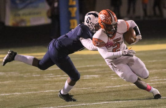 Mansfield Senior's Cyrus Ellerbe came up with a huge blocked field goal in overtime to help the Tygers beat Sandusky 15-9 on Friday night.