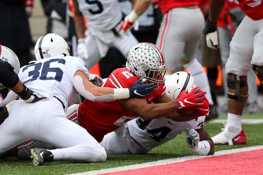 Ohio State tailback J.K. Dobbins crosses the goal line for the first of his two first half touchdowns Saturday.