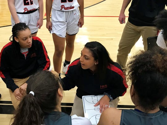 Marion Harding girls basketball coach Misty Starks talks to her team between quarters in a game against Worthington Kilbourne.