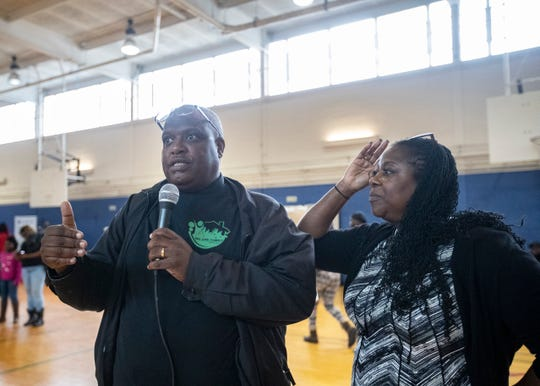 Tracey and Keith Millbrook overcame crack addictions and homelessness. On Nov. 21, they gave away 1,600 food baskets at the Ed Rice Community Center in Memphis.