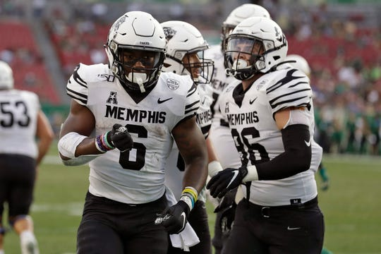 Memphis running back Patrick Taylor Jr. (6) celebrates his touchdown against South Florida during the first half of an NCAA college football game Saturday, Nov. 23, 2019, in Tampa, Fla.