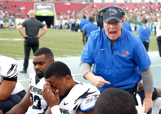 Nov 23, 2019; Tampa, FL, USA; Memphis Tigers defensive coordinator Adam Fuller (top right) talks to his players during the first quarter against the South Florida Bulls at Raymond James Stadium.