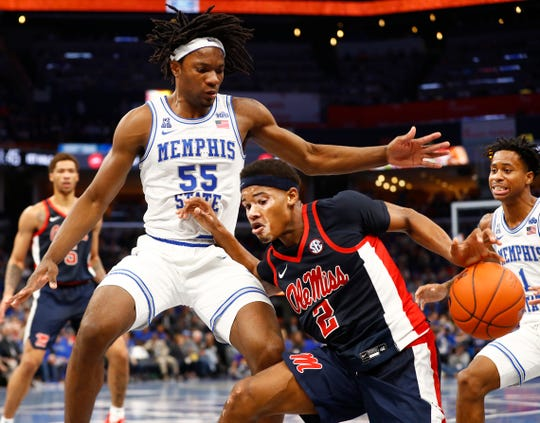 Memphis Tigers forward Precious Achiuwa (55) and Tyler Harris (1) defend against Ole Miss guard 	Devontae Shuler during their game at the FedExForum on Saturday, Nov. 23, 2019.