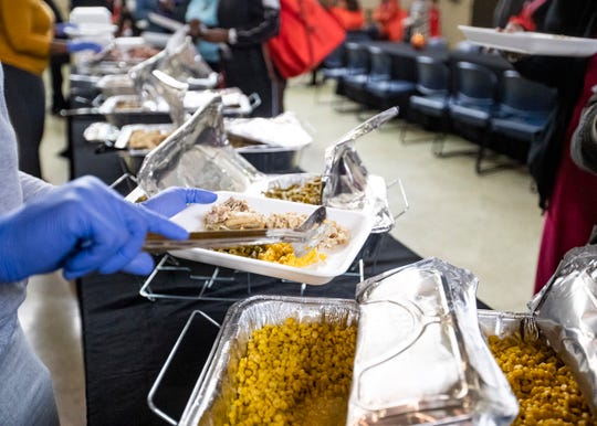 Thanksgiving dinner is served to families at the Ed Rice Community Center in Memphis on Nov. 21.