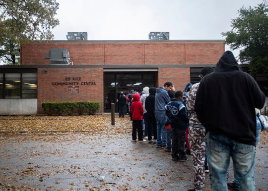 A long line forms outride of the Ed Rice Community Center on Nov. 21.