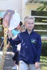 Connor Rice lead's the class with his turkey balloon and Tommie Barfield gear.