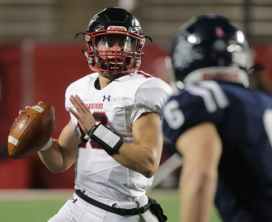 Muskego quarterback Connor Grohman gets ready to throw a pass against Bay Port in the second quarter.