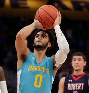 Marquette guard Markus Howard hits a free throw. Six of his 11 points were free throws Saturday.