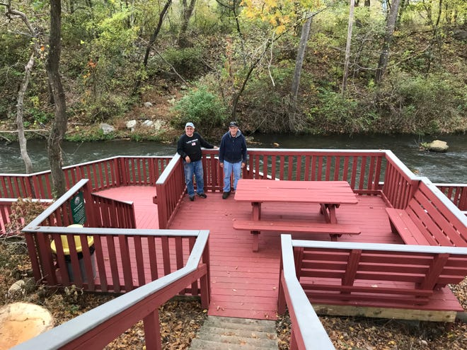 Tom Emerick (left) and Roger Cannady (right) stand on the Dry Run Creek deck. Emerick, Cannady and several other volunteers recently renovated the creek's decking and railing.