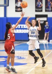 Cotter's Candace Lambert passes during the Lady Warriors' win against Green Forest on Friday night.