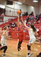 Norfork's Kylie Manes puts up a shot against Bergman in the Arvest Bank Tournament championship on Saturday at Flippin.