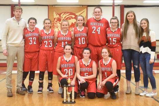 The Norfork Lady Panthers were runners-up in the Arvest Bank Tournament at Flippin. Members of the team are: (front row, from left) Eva Maple, Mesa Beavers, Madison Hall; (back row) coach Will Stewart, Riley Moody, Kylie Manes, Micah Dwyer, Aeja McFall, Hannah Bryant, Madison Lawrence, Kynzie Rangel, and Aaliyah Manes.