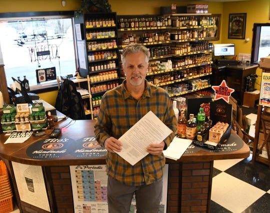 Midtown Spirits owner Jerry McDonald holds the signature pages for a petition that would authorize the sale of alcohol on Sundays at stores in Mountain Home. The petition has until Dec. 3 to collect more than 600 signatures to be placed on the March 3 election ballot.