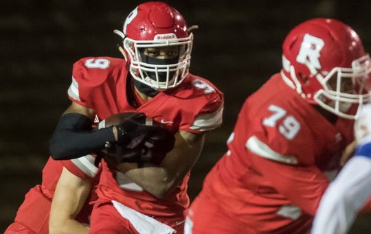 """Ruston's Ke'Travion Hargrove (9) carries the ball during the playoff game against East Acension at L.J. Garrett """"Hoss"""" Stadium in Ruston, La. on Nov. 22."""