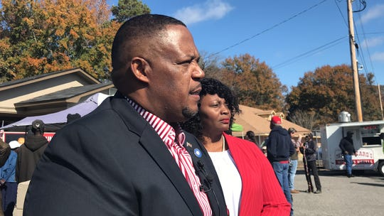 Kenneth Wilson and his wife Abbie Wilson speak to media outside of PEEP headquarters on Saturday. District 4 councilman Kenneth Wilson announced he will not seek a third term at the event.