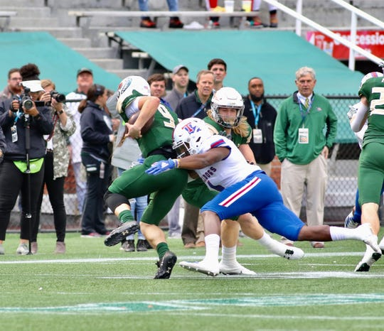 Louisiana Tech senior safety Darryl Lewis (4) makes a tackle on UAB redshirt freshman quarterback Dylan Hopkins (9) during a Conference USA game at Legion Field in Birmingham Saturday, Nov. 23, 2019.