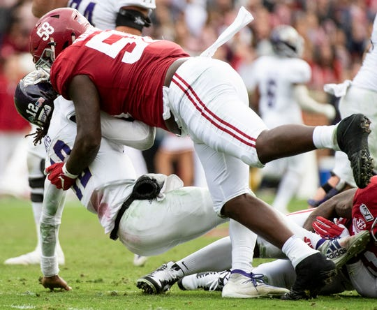 Alabama defensive lineman Christian Barmore (58) sacks Western Carolina quarterback Tyrie Adams (12) at Bryant-Denny Stadium in Tuscaloosa, Ala., on Saturday, November 23, 2019.