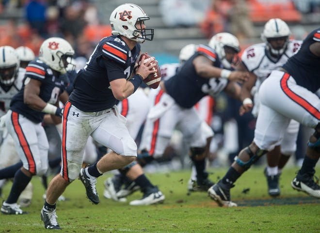 Auburn quarterback Cord Sandberg (24) runs to the outside  at Jordan-Hare Stadium in Auburn, Ala., on Saturday, Nov. 23, 2019. Auburn defeated Samford 52-0.